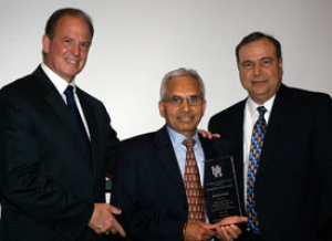 Dean Joseph Tedesco, Darshan Singh (1971 MSIE) and Hamid Parsaei, professor and chair of industrial engineering, at the Department of Industrial Engineering Awards Banquet. Photo by Gregory Bohuslav.