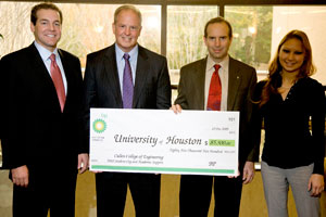 UH Cullen College of Engineering alumni Gabriel Cuadra (1988 BSChE) and Lizzie Nguyen (2006 BSChE) present Dean Joseph Tedesco and Russell Dunlavy, director of development, a check for $85,500 to support the college's Wind Energy Undergraduate Experiment as well as its departments and student organizations.