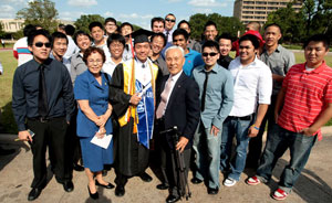 Graduate Tony Kim with his family and friends last Friday at the UH Cullen College of Engineering commencement ceremony. Photo by Tom Shea