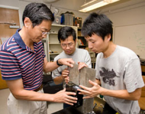 Professor Richard Liu (left) works with graduate students Yu Cai and Yinan Xing on the vehicle-mounted laser device developed in the Cullen College's Subsurface Sensing Lab. Photo by Thomas Shea
