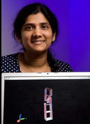 Yashashree Kulkarni shows off an example of her computational modeling, a technique she is using to improve on a new class of materials that could make metals stronger. Photo by Thomas Shea.