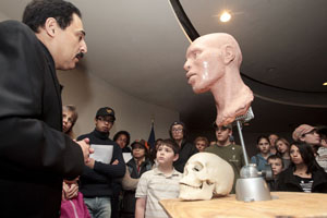 Ali Kamrani, associate professor of industrial engineering at UH, talks to students with The Friends School about the process he used to create replica skulls of three buffalo soldiers on a recent visit to the February museum exhibit. Photo by Thomas Shea.