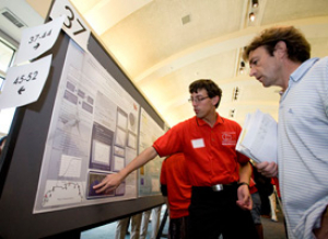 Mechanical engineering student Ethan Pedneau showcases his poster at the 6th Annual Undergraduate Research Day at the University of Houston. Photo by Thomas Shea.