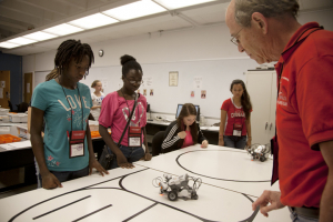 High School students who attended last year's G.R.A.D.E. Camp learned about robotics from ECE Professor John Glover.