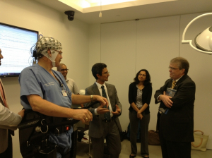 Prof. Contreras-Vidal explains to Rep. Culberson (right) how the brain-machine interface to the Rehab Rex exoskeleton works.