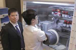 Yan Yao in his lab with a student researcher.
