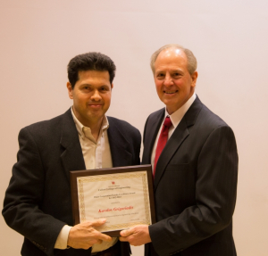 Grigoriadis Accepts Award From Dean Tedesco