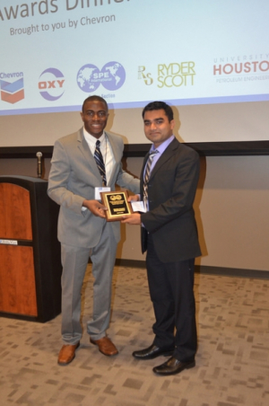 Rahul Pandey (right) receives third place in SPE Gulf Coast Regional Paper Contest