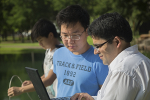 Dr. Saurabh Prasad collects ground data alongside two of his Ph.D. students.