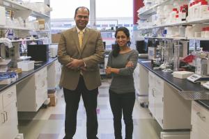 Birla (left) with Patel in his lab.