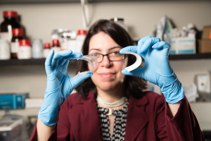 Powering the world: Haleh Ardebili, Bill D. Cook Assistant Professor in mechanical engineering, with her bendable battery roughly the size of a business card