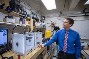 Always thinking, always inventing: Professor Aaron Becker in his lab