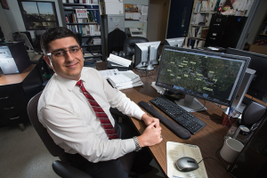 At the controls: Environmental engineering Ph.D student Amin Kiaghadi studies bodies of water to develop his ideas