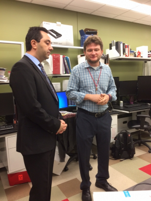 Ferhat Alkan (L), Houston's Turkish consul general, visits with biomedical Professor Sergy Shevkoplyas