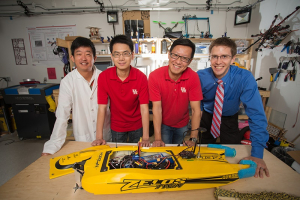 The brains in the lab: From left to right, Zhu Han, Jiefu Chen, Miao Pan, Aaron Becker and robot