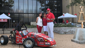 Joseph Tedesco (right), Dean of the Cullen College, poses with his wife Sue (middle) and Nayeli Martinez, a member of the UH Society of Automotive Engineers