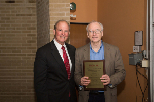 Joseph W. Tedesco, left, presents plaque to Engineering Rockwell lecturer Ronald Larson