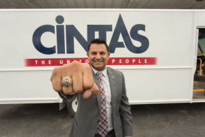 Eric Ayanegui proudly shows off his UH class ring at the Cintas facility in Houston.
