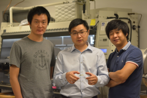 Cunjiang Yu, Bill D. Cook Assistant Professor of mechanical engineering, center, and co-first authors Xu Wang, left, and Kyoseung Sim, right)