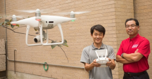 Gino Lim (right) and Seon Jin Kim with their airborne drone