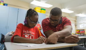 Cullen College student and iEducate tutor Jameel Jordan at work at Blackshear Elementary