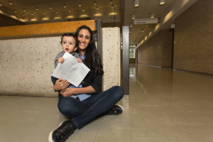 """I almost feel I have given birth to two babies,"" says grad student Sana Krichen. Her son Youssef Khadimallah, now 10 months old, holds his mother's just-published article about the role electromagnetism plays in some animal species' navigation skills. The article was first submitted to the journal Physical Review E at the time Krichen learned she was pregnant and – after much back-and-forth with reviewers – was released October 4."