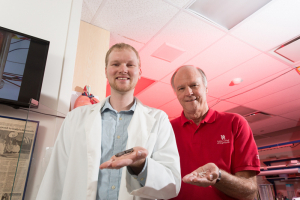 Ph.D. student Alex Smith (left) and mechanical engineering professor Ralph Metcalfe are collaborating with researchers at the Texas Heart Institute to radically improve blood-pumping devices for patients with heart failure