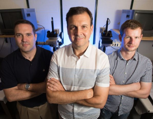 Peter Vekilov, center, with Jeffrey Rimer, left, and Jeremy Palmer, right, in front of the big guns - the atomic force microscopes,