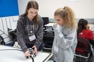 Julie Rogers, a Cullen College mechanical engineering senior and a G.R.A.D.E. Camp counselor, works with camper Natalie Cramer, an 8th-grader from Pearland.