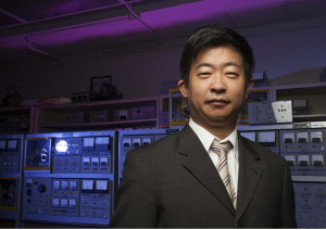 Zhu Han, a UH engineering professor, is working on a $7.5 million DoD grant project using game theory to analyze and influence social behavior.
