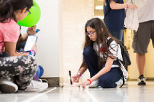 A girl tests her propeller-powered car at the 2018 Girls Engineering the Future! at the UH Cullen College.