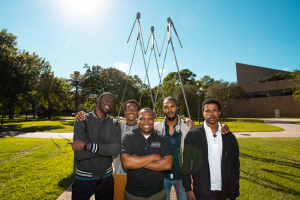 Professor Jerrod Henderson with some of his Cullen College students (L to R): Helder Mandingo, Tarami Readus, Peter Bristow and Kameron Bass.