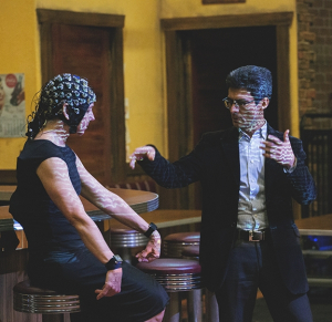 """Jose Contreras-Vidal, a UH researcher, in discussion with a dancer for his """"Brain on Art"""" research."""