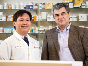 College of Pharmacy professor Vincent Tam, left, and Michael Nikolaou, professor of chemical and biomolecular engineering, are battling resistant bacteria, taking the guess work out of choosing the proper antibiotic combinations by building a device that will suggest combinations.