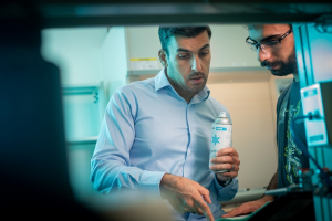 UH Cullen College of Engineering professor Hadi Ghasemi in the SurfEllent lab with a student researcher.