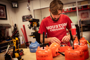 UH ECE student Jarrett Lonsford works on the electronics for a sensing drift node in Dr. Aaron Becker's lab on Thursday, Oct. 3, 2019.