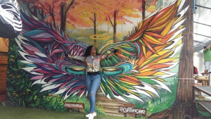 Rosa Futy, a UH chemical engineering student, poses with some Brazilian street art.