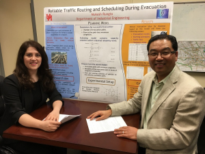 Professor Gino Lim and his doctoral student Ayda Darvishan with a poster about their emergency evacuation project.