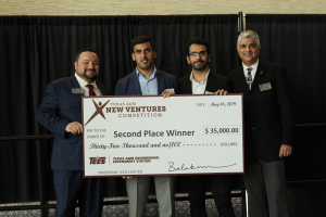 Hadi Ghasemi, Bill D. Cook Assistant Professor of mechanical engineering at the UH Cullen College of Engineering, accepts his 2019 Texas A&M New Ventures Competition (TNVC) winnings.