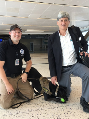 Stuart Long, UH professor of electrical and computer engineering, with a TSA handler and his passenger-screening canine.