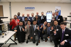 Omron representatives pose with UH electrical and computer engineering students.