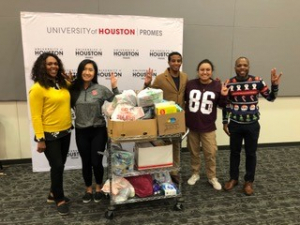 PROMES representatives with 140 pounds of donations for the UH PEEPS Pantry, a free food pantry to help students in need.