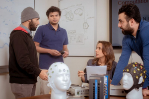 Rafiul Amin (left), Ph.D. graduate Dilranjan Wickramasuriya (left center) and Hamid Fekri Azgomi (right) speak with Rose Faghih (right center) about the MINDWATCH project. Amin and Fekri Azgomi gave a presentation on the research for the National Science Foundation's Cyber-Physical Systems (CPS) Principal Investigators' meetings from June 2 through June 4 in 2021.