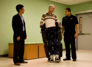 Professor Jose Luis Contreras-Vidal (left) at a recent demonstration of a Rex Bionics exoskeleton at the University of Houston. Contreras-Vidal is developing a brain-machine interface that will allow users to control such devices through their thoughts. Photo by Nine Nguyen.