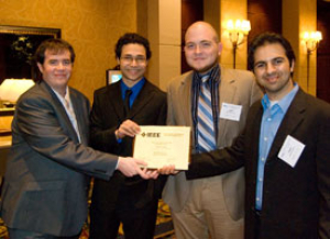 Team members James Beamer (left), Carlos Moran, John Hemmick and Osaid Shamsi show off the award signifying their first place win in the robotics competition at the Institute of Electrical and Electronics Engineers (IEEE) Region 5 Technical, Professional and Student Conference April 17. Contributed Photo.