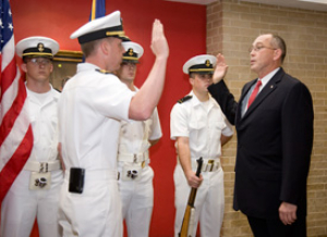 Lawrence Schulze, professor of industrial engineering, is commissed as the regional Naval Campus Liaison Officer.