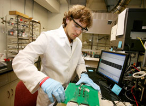 Chemical engineering senior Rhys Forgie works in the lab as part the college's Research Experience for Undergraduates program. Photo by Thomas Shea.