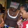 GRADE Camp mentor, Bose Olomola, teaches Kristine Singleton about how to read the infrared sensor measurements on her robot. Photo by Jeff Shaw.