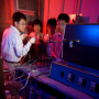 Assistant Research Professor Qingkai Yu working in the lab with electrical and computer engineering graduate students Zhihua Su and Wei Wu and postdoctoral researcher Zhihong Liu. Photo by Thomas Shea.