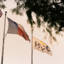 An exterior shot of the flags flying at the Houston Community College's Fraga Campus. The University of Houston's Cullen College of Engineering and HCC will be partnering to create an Engineering Academy on the campus.